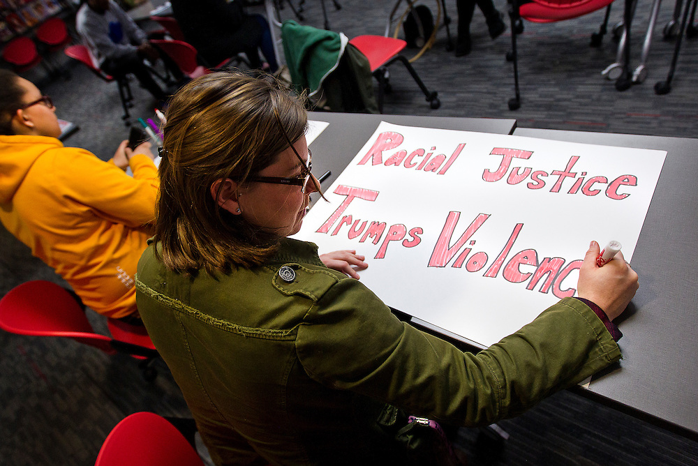 MADISON, WI – MARCH 27: Shawna Lutzow designs a protest sign at the UW South Madison Partnership space in advance of Presidential candidate Donald Trump's visit to Janesville, Wisconsin.