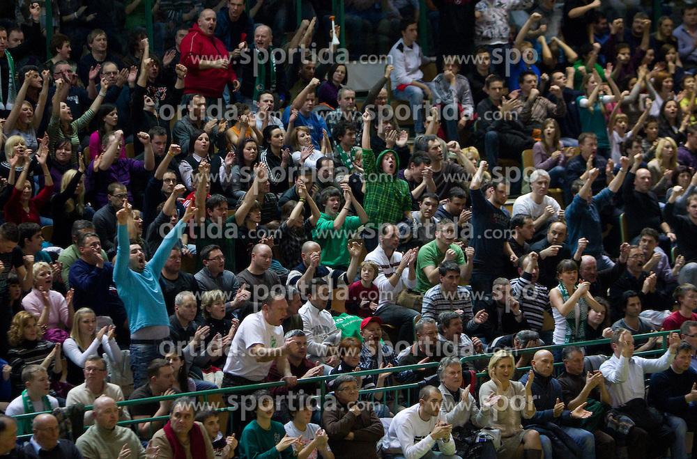 Spectators during basketball match between KK Krka (SLO) and Union Olimpija (SLO) in 16th Round of NLB Adriatic League, on January 11, 2011 in Arena Leona Stuklja, Novo mesto, Slovenia. Olimpija defeated Krka 80-75. (Photo By Vid Ponikvar / Sportida.com)