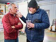 """24 JANUARY 2020 - POLK CITY, IOWA: JOE WALSH, left, talks to JAMES MARREN, from the Veterans National Recovery Center, before a campaign event in Polk City, northwest of Des Moines. Walsh, a conservative radio personality, former Republican congressman, and one time supporter of Donald Trump is now challenging Trump for the Republican nomination for the US Presidency. During his appearance in Polk City, Walsh said Trump is unfit to be the President because he is a """"cheater,"""" a climate change denier, and a """"threat"""" to the United States.      PHOTO BY JACK KURTZ"""