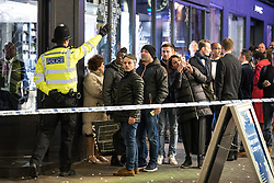 © Licensed to London News Pictures. 24/11/2017. London, UK. A policeman directs the public away from a police cordon on London's Carnaby Street as police deal with an incident at Oxford Circus. Photo credit: Rob Pinney/LNP