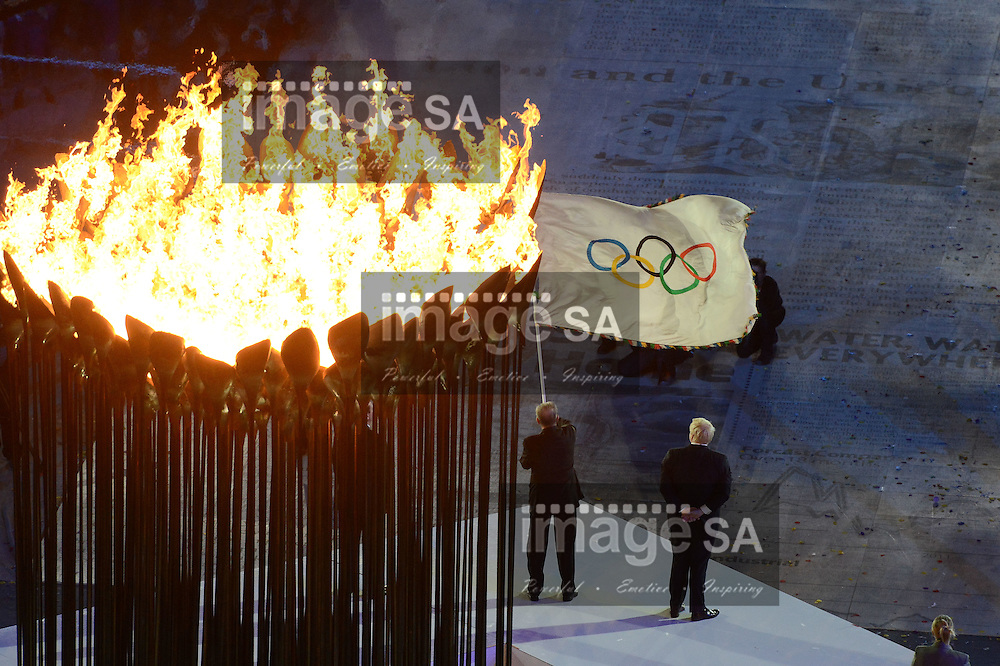 LONDON, ENGLAND - AUGUST 12,  Mr Jacques Rogge, President of the IOC, waves the Olympic flag during the closing ceremony of the London 2012 Olympic Games at the Olympic Park stadium, on August 12, 2012 in London, England.Photo by Roger Sedres / Gallo Images