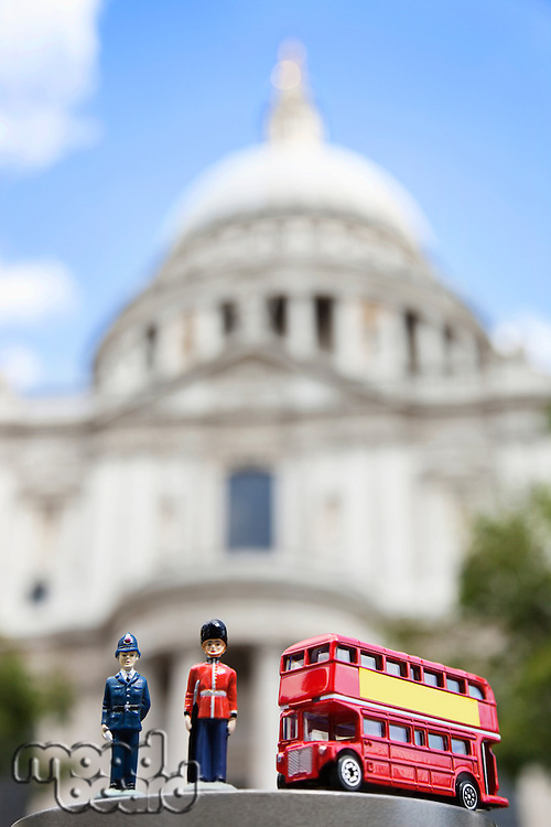Figurines of London officers and double-decker bus with St. Paul's Cathedral in background