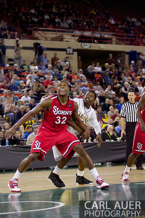 November 27th, 2010:  Anchorage, Alaska - St. John's Justin Brownlee (32) and Arizona State's Carrick Felix during a free throw in the Red Storm's 67-58 victory against the Arizona State Sun Devil's to win the championship game of the Great Alaska Shootout.