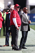Arizona Cardinals head coach Bruce Arians and FOX Sports sideline reporter Ronde Barber in action during the 2016 NFL week 17 regular season football game against the Los Angeles Rams on Sunday, Jan. 1, 2017 in Los Angeles. The Cardinals won the game 44-6. (©Paul Anthony Spinelli)