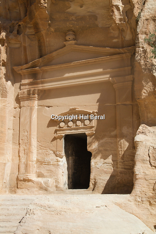 Temple carved into a stone cliff by the Nabateans more than 2200 years ago<br /> Little Petra (Siq al-Barid), Jordan