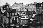 A section of the Père Lachaise cemetary with apartment buildings in the background. The Père Lachaise Cemetery in Paris opened in 1804, and is the world's most visited cemetery.