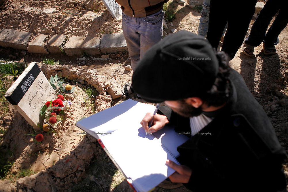 Student Ammar Obaid located and registers names of victims and belonging graves on the Free Martyr Cemetery in wetsern Deir az-Zor which was a playground before the war. Residents of eastern syrian town Deir az-Zor joined arab spring protests against the regime of Bashar al-Assad from its early beginning in March 2011. Since summer 2012 the town with few hundred thousand inhabitants is embattled between the Syrian Army and different opposing rebel groups like Free Syrian Army and Jabhat al-Nusra. Deir az-Zor is target to constant shelling by artillery, war planes and short range missiles. Almost 70 percent of the town is rebel held while government forces remain in control over some residental areas and a strategic important airport. Deir az-Zor is widely damaged and some areas almost totally destroyed by fierce and long lasting battles. All direct road connections to Deir az-Zor are cut and fighters and returning residents as well depend on one provisional supply line across the Euphrates river which is regularly targeted by government snipers.