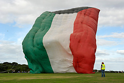 © Licensed to London News Pictures. 31/08/2013. Bristol, UK.  The world's largest kite, in the colours of the Kuwaiti flag is flown briefly by the Al Farsi Kite Team at The Bristol International Kite Festival at Ashton Court Estate.  Guest flyers from across the world have flown in specially to create a  spectacle of both special shaped kites, and team displays. 31 August 2013.<br /> Photo credit : Simon Chapman/LNP
