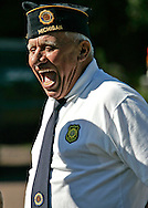 Mitch Seeling of the Rockland, Michigan, American Legion roars in laughter after a memorial service on July 30, 2005.  ....