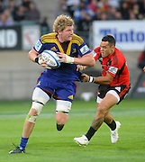 Highlanders Adam Thomson brakes the tackle of crusaders Kahn Fotuali during the Investec Super Rugby - Highlanders v Crusaders, 19 March 2011, Carisbrook Stadium, Dunedin, New Zealand.Photo: New Zealand. Photo: Richard Hood/www.photosport.co.nz