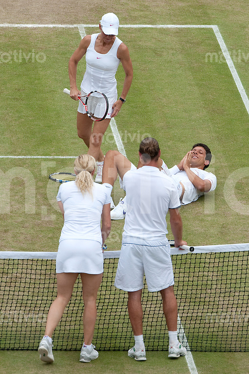 Marcelo Melo (BRA) and Rennae Stubbs (AUS) play against Xavier Melisse (BEL) and Kim Clijsters (BEL) on Court 1. The Wimbledon Championships 2010 The All England Lawn Tennis & Croquet Club  Day 10 Thursday 01/07/2010