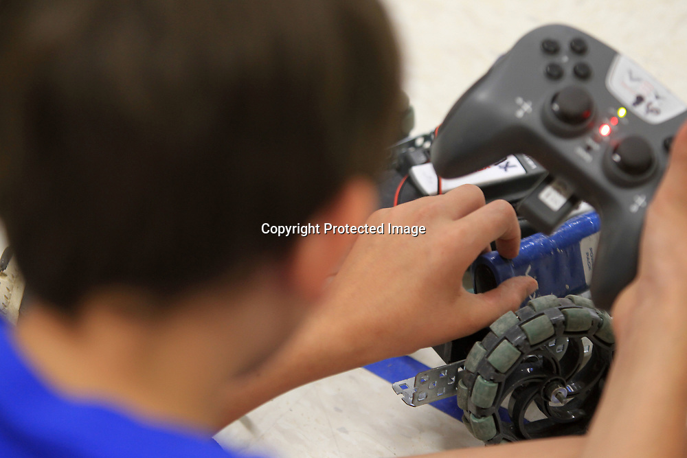 "Thomas Smith, 12, replaces the battery in his robot called ""The Fidgety of Death"" in the VEX Robotics class at the Tupelo Public School District's Camp Opportunity held at Lawndale Elementary School."