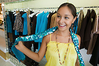 Girl Trying on Sequin Boa in clothing store
