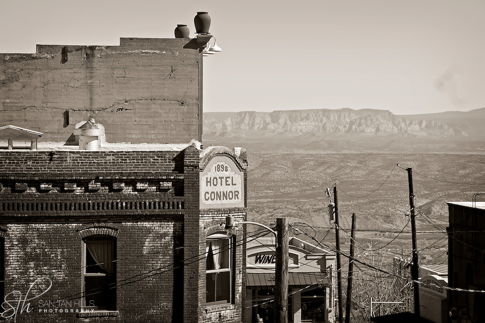 Viewing a distant Sedona over the rooftops of Jerome, AZ