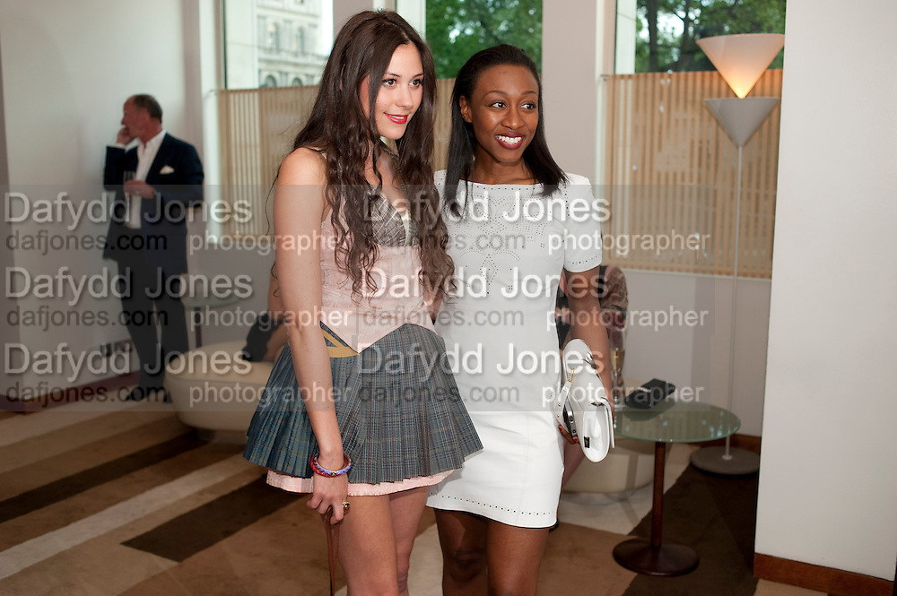 ELIZA DOOLITTLE; BEVERLEY KNIGHT, The Tomodachi ( Friends) Charity Dinner hosted by Chef Nobu Matsuhisa in aid of the Japanese Tsunami Appeal. Nobu Park Lane. London. 4 May 2011. <br /> <br />  , -DO NOT ARCHIVE-&copy; Copyright Photograph by Dafydd Jones. 248 Clapham Rd. London SW9 0PZ. Tel 0207 820 0771. www.dafjones.com.