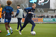 AFC Wimbledon midfielder Mitchell (Mitch) Pinnock (11) warming up during the EFL Sky Bet League 1 match between AFC Wimbledon and Southend United at the Cherry Red Records Stadium, Kingston, England on 1 January 2020.