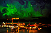 Playful coloration of northern lights over sea plane base in Kodiak, Alaska using Photoshop