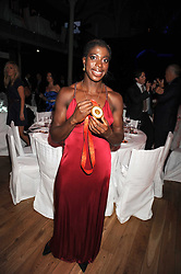 Beijing Olympic 400m Gold medal winner CHRISTINE OHURUOGU with her medal at the GQ Men of the Year Awards held at the Royal Opera House, London on 2nd September 2008.<br /> <br /> NON EXCLUSIVE - WORLD RIGHTS