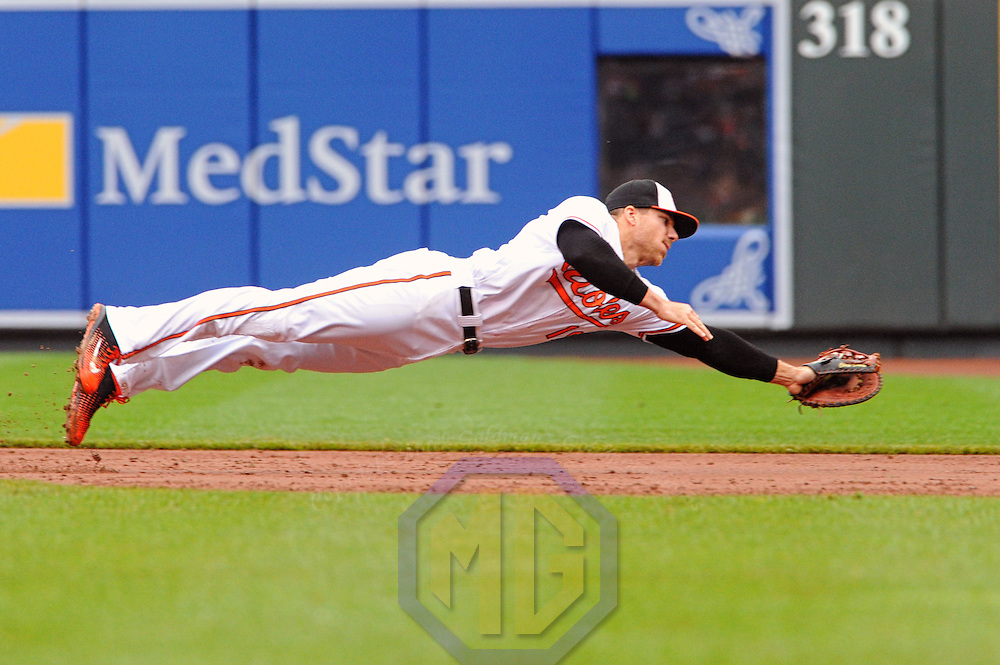 1 May 2016:  Baltimore Orioles first baseman Chris Davis (19) makes a diving stop against the Chicago White Sox at Orioles Park at Camden Yards in Baltimore, MD. where the Chicago White Sox defeated the Baltimore Orioles, 7-1.(Photograph by Mark Goldman/Icon Sportswire)