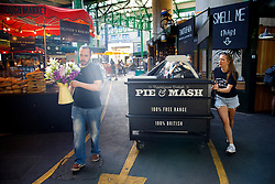© Licensed to London News Pictures. 14/06/2017. London, UK. Shop owners and traders get ready for the reopening of Borough Market in London on 14 June 2017, following a terror attack that killed 8 people over a week ago. Photo credit: Tolga Akmen/LNP