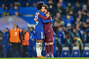 Goal scorers Barcelona forward Lionel Messi  (10) and Chelsea midfielder Willian (22) hug each other at the end of  the Champions League match between Chelsea and Barcelona at Stamford Bridge, London, England on 20 February 2018. Picture by Martin Cole.