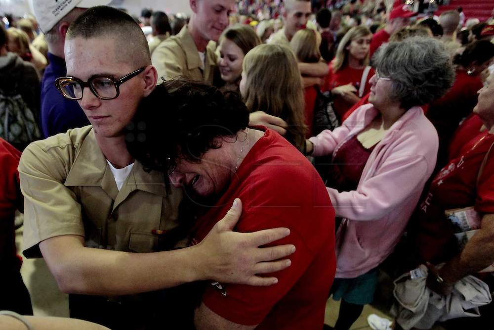 A mother cries as she sees her son for the first time in twelve weeks the day before he graduates.  Marine Corps Recruit Depot at Parris Island in South Carolina is where all male recruits living east of the Mississippi River and all female recruits from all over the US receive their arduous twelve week training in their quest to become marines. Even though there are two current active wars and a weak economy, recruitment has not been effected.  Actually, recruiting numbers have increased, with more young men and women looking toward the military for answers.