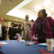 A U.S. Census worker speaks to job seekers at a job fair at the Rosslyn Holiday Inn in Arlington, VA on Friday, Jan. 15, 2010.