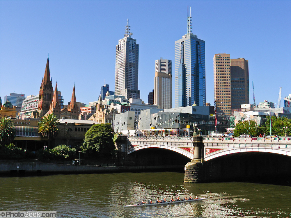 "Melbourne spreads around the large natural bay of Port Phillip, with the city centre on the estuary of Yarra River, and it claims the world's largest tram network. Melbourne is the capital and most populous city (4 million in 2009) in the state of Victoria, and the second most populous city in Australia. Melbourne was founded in 1835 (47 years after the European settlement of Australia) by settlers from Van Diemen's Land. It was named by governor Richard Bourke in 1837, in honour of the British Prime Minister of the day, William Lamb—the 2nd Viscount Melbourne. During the Victorian gold rush of the 1850s, Melburnians transformed it into one of the world's largest and wealthiest cities. As the ""cultural capital of Australia"", Melbourne is the birthplace of Australian film (as well as the world's first feature film), Australian television, and Australian Rules football."