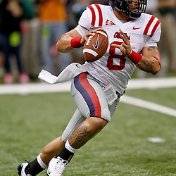 Sep 11, 2010; New Orleans, LA, USA; Mississippi Rebels quarterback Jeremiah Masoli (8) scrambles with the ball against the Tulane Green Wave during the first half at the Louisiana Superdome.  Mandatory Credit: Derick E. Hingle