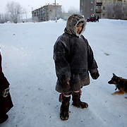 Reindeer herder Vanya travel hours by sled from his tent in the tundra to buy supplies at the village shop in Sovetsky..Nomadic people like Vanya have a mutually cautious relationship with the Russians who live in the Far North..Vorkuta is a coal mining and former Gulag town 1,200 miles north east of Moscow, beyond the Arctic Circle, where temperatures in winter drop to -50C. .Here, whole villages are being slowly deserted and reclaimed by snow, while the financial crisis is squeezing coal mining companies that already struggle to find workers..Moscow says its Far North is a strategic region, targeting huge investment to exploit its oil and gas resources. But there is a paradox: the Far North is actually dying. Every year thousands of people from towns and cities in the Russian Arctic are fleeing south. The system of subsidies that propped up Siberia and the Arctic in the Soviet times has crumbled. Now there?s no advantage to living in the Far North - salaries are no higher than in central Russia and prices for goods are higher.