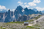 "The peaks of the Cadini Group jut high above Rifugio Lavaredo in the Dolomites, near Cortina d'Ampezzo, Italy, Europe. In the Cadini di Misurina, Cima Grande rises to 2999 meters (9839 feet), between Cima Piccola and Cima Ovest. Hike for spectacular views around Tre Cime di Lavaredo (Italian for ""Three Peaks of Lavaredo,"" or in German called Drei Zinnen, ""Three Merlons""). The Dolomites are part of the Southern Limestone Alps, in northern Italy, Europe. UNESCO honored the Dolomites as a natural World Heritage Site in 2009."