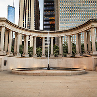 Chicago Millennium Monument in Wrigley Square Millennium Park. The peristyle monument and fountain has greek style columns and contains the names of the founders of Millennium Park.