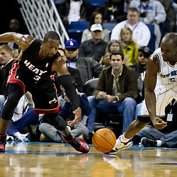 November 5, 2010; New Orleans, LA, USA;  Miami Heat shooting guard Dwyane Wade (3) and New Orleans Hornets center Emeka Okafor (50) reach for a loose ball Miami Heat shooting guard Dwyane Wade (3) a game at the New Orleans Arena. The Hornets defeated the Heat 96-93. Mandatory Credit: Derick E. Hingle
