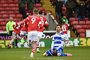 Queens Park Rangers Captain Grant Hall sits on the floor as Cauley Woodrow of Barnsley FC celebrates his team's first goal during the EFL Sky Bet Championship match between Barnsley and Queens Park Rangers at Oakwell, Barnsley, England on 14 December 2019.