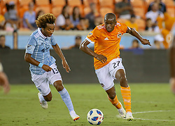 August 4, 2018 - Houston, TX, U.S. - HOUSTON, TX - AUGUST 04:  Houston Dynamo midfielder Oscar Garcia (27) keeps the ball away from Sporting Kansas City forward Gianluca Busio (13) during the soccer match between Sporting Kansas City and Houston Dynamo on August 4, 2018 at BBVA Compass Stadium in Houston, Texas.  (Photo by Leslie Plaza Johnson/Icon Sportswire) (Credit Image: © Leslie Plaza Johnson/Icon SMI via ZUMA Press)
