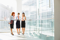 Full-length of businesswomen discussing in office