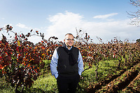 GUAGNANO, ITALY - 10 NOVEMBER 2016: Gianvito Rizzo (53), inventor of the sommelier courses at Lecce prison and chief executive officer at the Feudi di Guagnano, the wine cellar that offered their wines for the classes, poses for a portrait in the vineyard of San Gaetano Thiene, a district of Guagnano near Lecce where the Negramaro wine is produced, Italy, on November 10th 2016.<br /> <br /> Here a group of ten high-security female inmates and aspiring sommeliers , some of which are married to mafia mobsters or have been convicted for criminal association (crimes carrying up to to decades of jail time), are taking a course of eight lessons to learn how to taste, choose and serve local wines.<br /> <br /> The classes are part of a wide-ranging educational program to teach inmates new professional skills, as well as help them develop a bond with the region they live in.<br /> <br /> Since the 1970s, Italian norms have been providing for reeducation and a personalized approach to detention. However, the lack of funds to rehabilitate inmates, alongside the chronic overcrowding of Italian prisons, have created a reality of thousands of incarcerated men and women with little to do all day long. Especially those with a serious criminal record, experts said, need dedicated therapy and professionals who can help them.