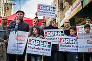 Palestinian human rights defender Issa Amro speaks at a press conference marking the beginning of the annual Open Shuhada Street campaign in Hebron.