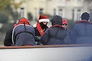 Putney, GREAT BRITAIN,    Xmas Hat, on the OUBC Supporters launch.  2008 Varsity/Oxford University [OUBC] Trial Eights, raced over the championship course. Putney to Mortlake, on the River Thames. Thurs. 11.08.2008 [Mandatory Credit, Peter Spurrier/Intersport-images].. Varsity Boat Race, Rowing Course: River Thames, Championship course, Putney to Mortlake 4.25 Miles,