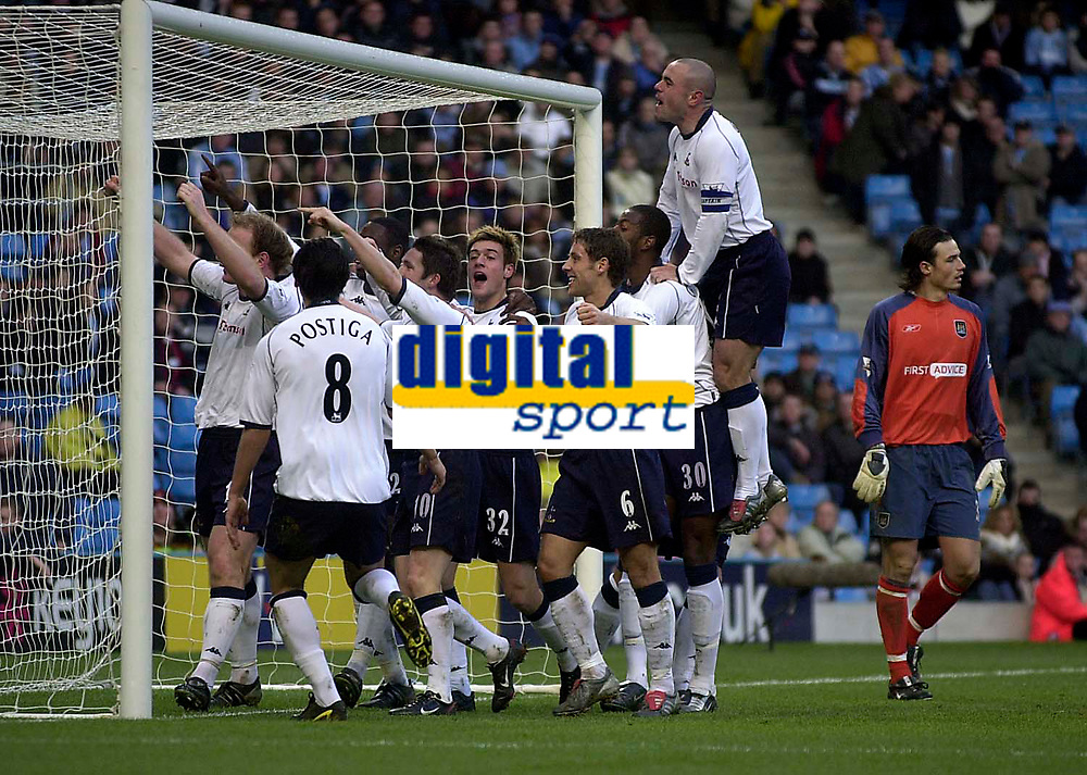 Photo. Glyn Thomas.<br /> Manchester City v Tottenham Hotspur. FA Cup fourth round. <br /> City of Manchester Stadium, Manchester. 25/01/2004.<br /> Spurs' Gary Doherty (L) is mobbed by teammates after scoring his side's equaliser as Kevin Ellegaard (R) looks dejected.