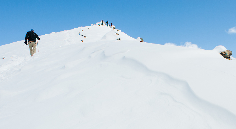 Man climbing a snowed Himalayan mountain