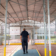 JULY 19, 2018----BAYAMON, PUERTO RICO---<br /> A prison guard walks into one of the buildings in the Bayamon Correctional Complex which is made up of four buildings. The Puerto Rico Corrections and Rehabilitation Department is in the middle of a project to downsize by transferring inmates to private jails in the United States and closing institutions like this.<br /> (Photo by Angel Valentin/Freelance)