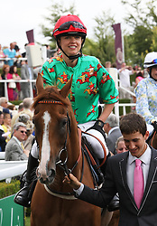 Sara Cox takes part in a ladies race at  Ladies Day at Glorious Goodwood, Thursday, 2nd August 2012 Photo by: Stephen Lock / i-Images