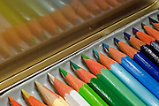 Sharpened coloured pencil crayons in their box