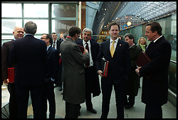 Britain's Prime Minister David Cameron with the Deputy Prime Minster Nick Clegg with Chris Huhne in the background at St Pancras Station, London, January, 2012 . Photo By Andrew Parsons/i-Images