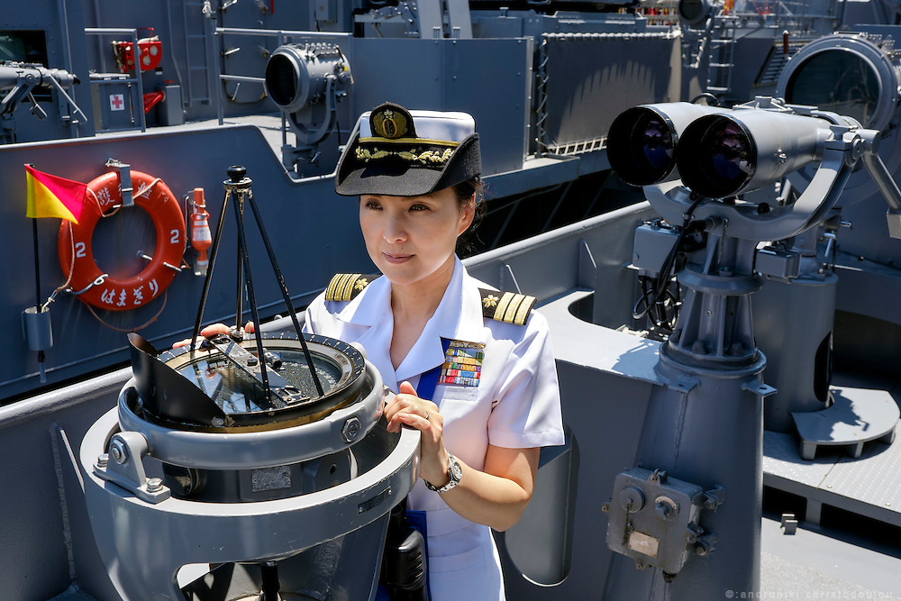 Miho Ootani, the first woman destroyer captain of Japan's Marine Self Defence Forces (MSDF), on board the Yamagiri in Yokosuka army base near Tokyo. Here by the compass located in the outdoors space of the bridge.