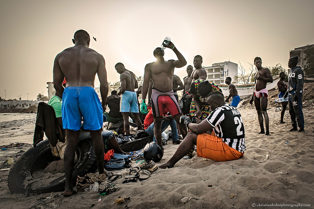 Young wrestlers relax after the hard training at the school of ex-Wrestler Boy Kaire at the Corniche in Dakar on April 3, 2015.