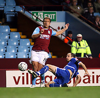 Photo: Mark Stephenson.<br /> Aston Villa v Leicester City. Carling Cup. 26/09/2007.Villa's Stiliyan Petrov gets tackeled  by Stephen Clemence