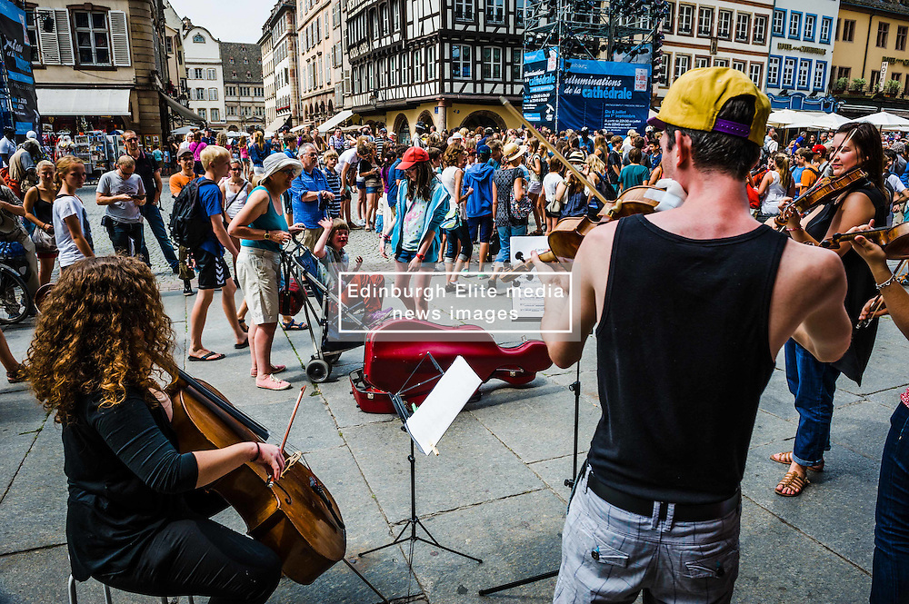 Student musicians playing for tourists outside the Cathedral in Strasbourg, Alsace, France<br /> <br /> (c) Andrew Wilson | Edinburgh Elite media