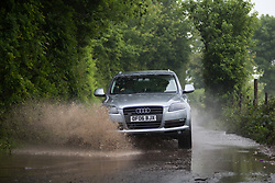 @Licensed to London News Pictures 29/05/2018. Kent. Cars struggle through country lanes in Bredhurst, Eknt as flash floods hit across Kent. Photo credit: Manu Palomeque/LNP